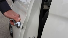 Hand opening white car door Stock Footage