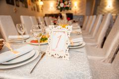 table set for wedding or another catered event - stock photo