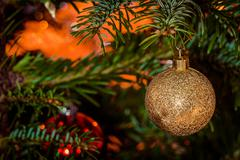 Glittering Xmas bauble in gold - stock photo