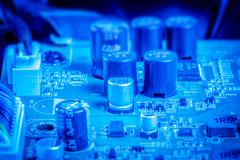 Power capacitors and chips in blue color Stock Photos