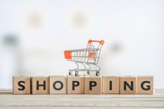 Shopping cart on a wooden sign Stock Photos