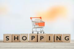 Shopping sign with a orange cart - stock photo