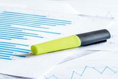 Yellow marker on a paper diagram Stock Photos