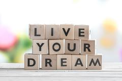 Living your dream words on a table Stock Photos
