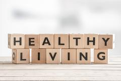 Healthy living sign with wooden cubes Stock Photos