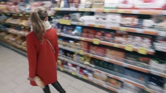 SAINT-PETERBURG/RUSSIA –    Young blond woman chooses food in Stock Footage