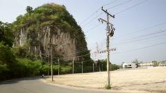 Krabi development land near Karst hill passing motorcycle Stock Footage