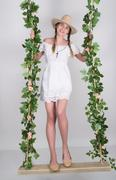 Full-length Beautiful young leggy blonde in a little white dress and white Stock Photos