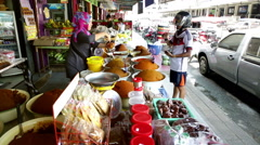 Powdered spice shop filling bags Street view Thailand Stock Footage