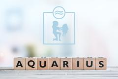 Aquarius star sign on a table - stock photo