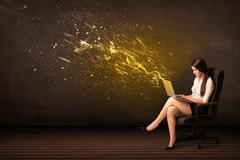 Businesswoman with laptop and energy explosion on background Stock Photos
