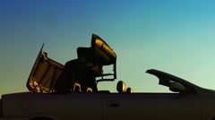 Closing Convertible Car Roof Silhouette at sunset Stock Footage