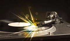 Music player playing vinyl with glow lines comming from the needle - stock photo