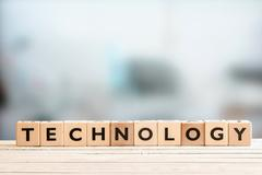 Stock Photo of Technology sign on a wooden desk