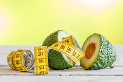 Avocado with yellow measure tape Stock Photos