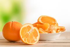 Oranges on a wooden table - stock photo