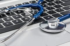 Medical Research, stethoscope on laptop keyboard Kuvituskuvat