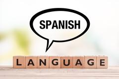 Spanish language lesson sign on a table - stock photo