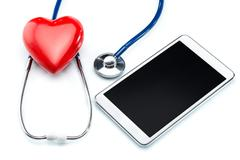 Heart disease research, stethoscope ,heart shape and Digital Tablet Stock Photos