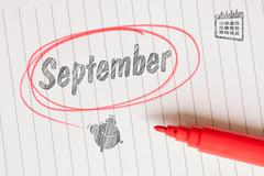 Stock Photo of September note with a red brush
