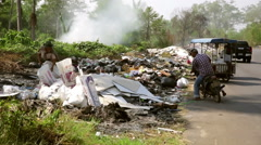 Asian road side Garbage dump people recycling  - stock footage