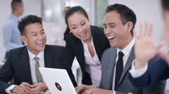 4K Asian corporate business group looking at computer in a meeting high five Stock Footage