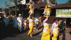 Balinese holiday procession on street Stock Footage