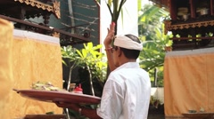 Balinese priest performing ritual offerings Stock Footage