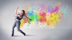 Young colorful street dancer with paint splash Stock Photos