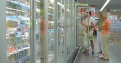Family by the Refrigerator in the Supermarket Stock Footage