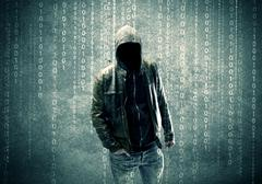 Angry mysterious hacker with numbers - stock photo
