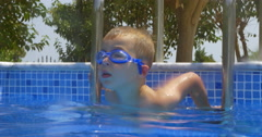 Smiling Boy in Goggles in Swimming Pool Stock Footage