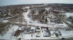 Tracking Sideways Over an old Neighborhood in the Snow Stock Footage