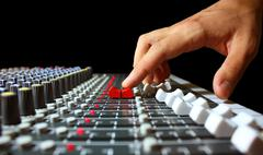 Hand on a mixer, operating the leader Stock Photos