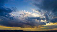 The flow of rain cloud on a background of the evening city. Time lapse Stock Footage