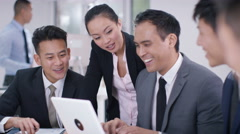 4K Asian corporate business group looking at computer in a meeting start clappin - stock footage