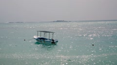 One romantic alone boat in blue sea - stock footage