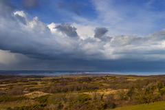 Rain-bearing clouds hang over the horizon over Poole Harbour Stock Photos