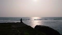 Dreamy Woman Enjoying Amazing Seascape during Sunrise. Beautiful Sunny Stock Footage