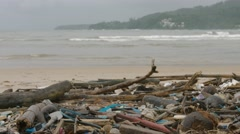 Polution in form of garbage and assorted debris, washed up on coast - stock footage