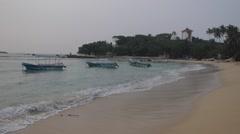 Calm sea with a three sway boats at sunrise, Sri lanka, Unawatuna beach - stock footage