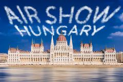 Traditional Air Show in Hungary at Hungarian Parliament on Danube in Budapest - stock photo