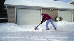 Woman Snow Shovelling with Ergonomic Snow Shovel - 2 Stock Footage