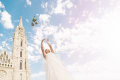 Bouquet Toss | Destination Wedding Budapest - stock photo