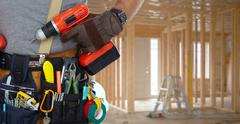 Builder handyman with drill. Stock Photos