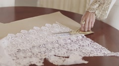 Woman cuts fabric scissors Stock Footage