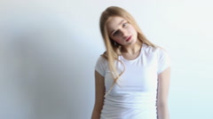 beautiful sexy young girl posing in the studio on a white background - stock footage