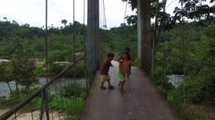 Children Playing on a Bridge in Ecuador Stock Footage