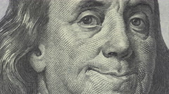 Animation of Ben Franklin smile an wink on $100 bill - stock footage