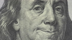 Animation of Ben Franklin smiling on $100 bill - stock footage